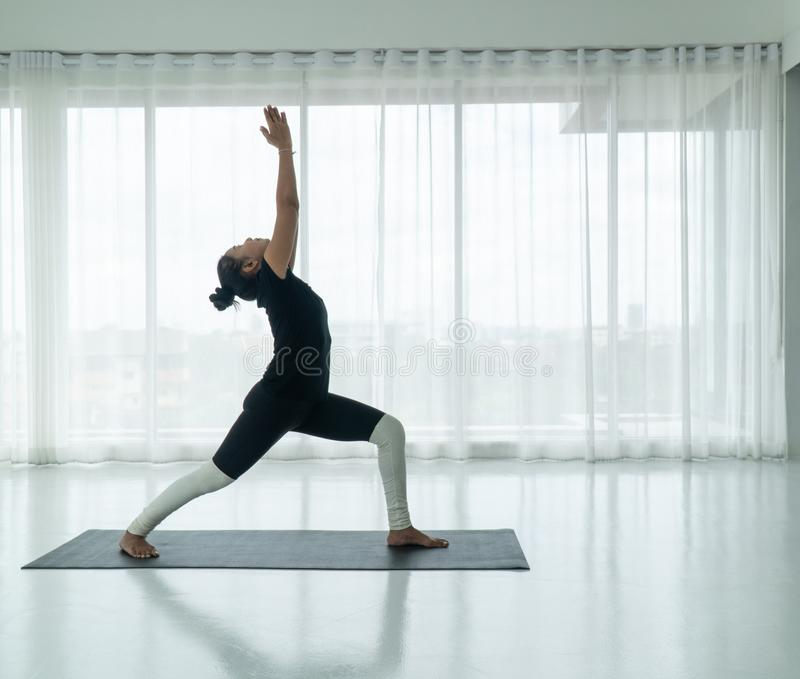 Yoga classes and meditation practice Making the body strong, stretching is a sport for both women and men. Yoga classes and meditation practice to strengthen the stock photo