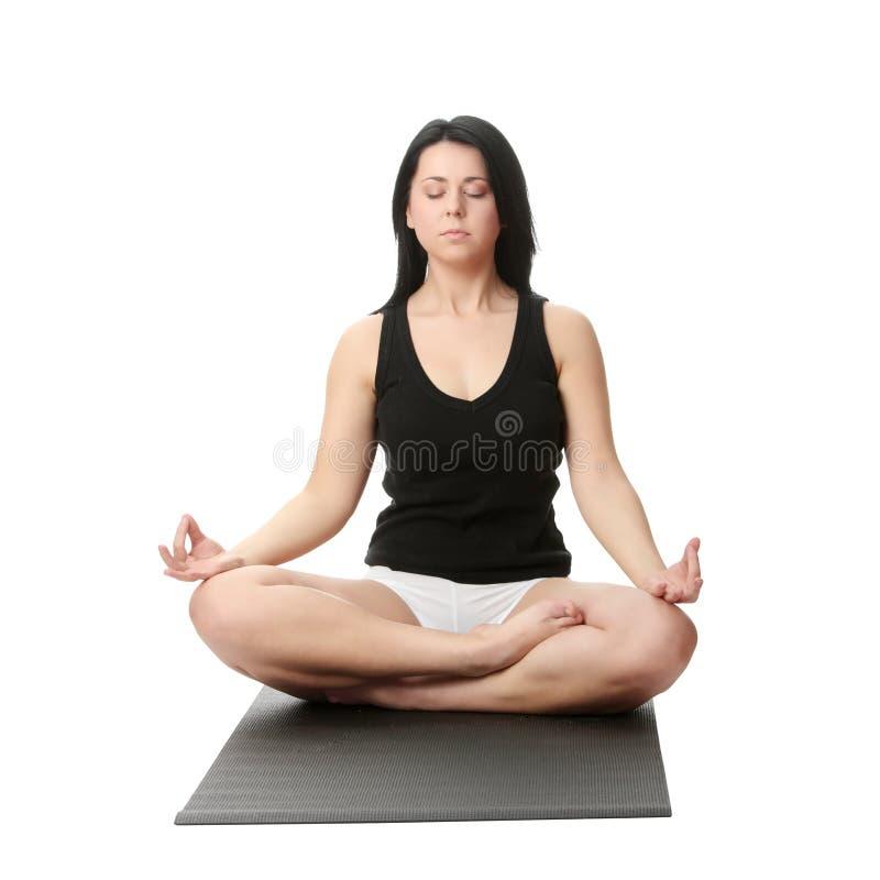 Yoga corpulent de formation de femme images libres de droits