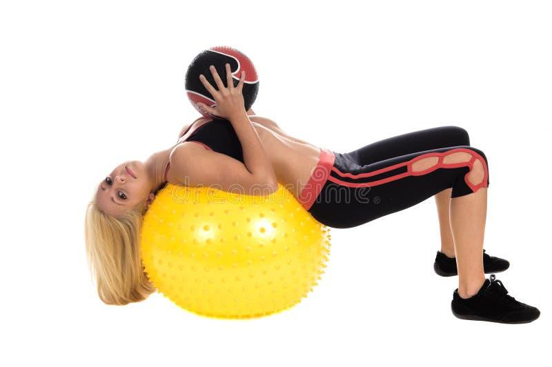 Yoga de la bola de medicina imagen de archivo libre de regalías