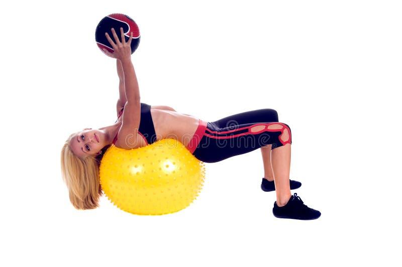 Yoga de la bola de medicina fotos de archivo
