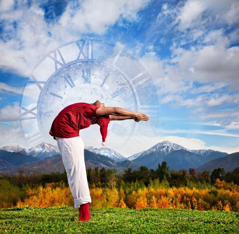 Yoga de Noël comme horloge photos stock