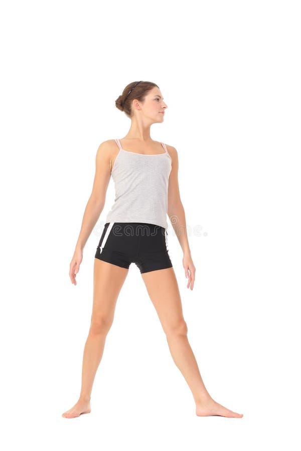 Yoga del entrenamiento de la mujer joven foto de archivo
