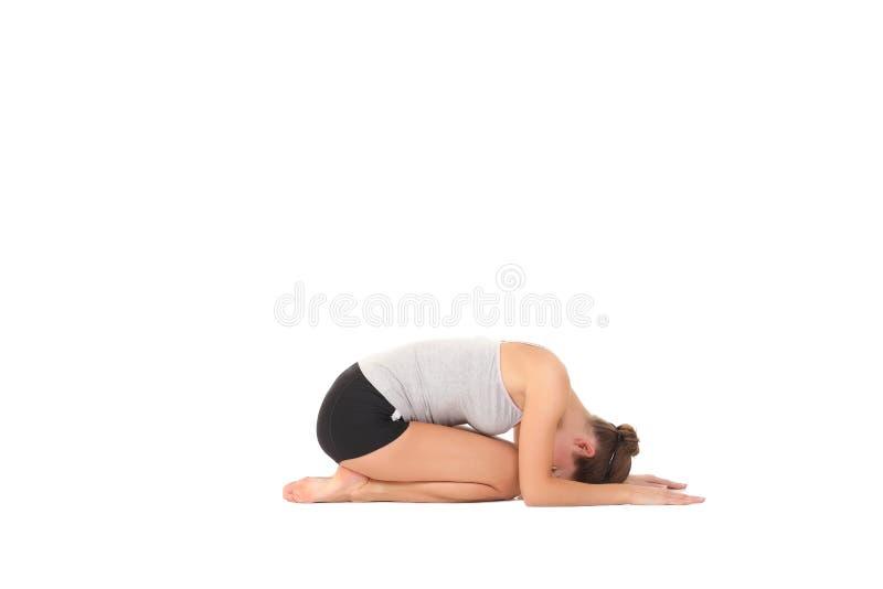 Yoga del entrenamiento de la mujer joven fotos de archivo