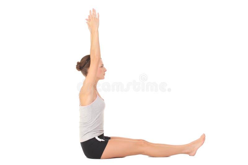 Yoga del entrenamiento de la mujer joven foto de archivo libre de regalías
