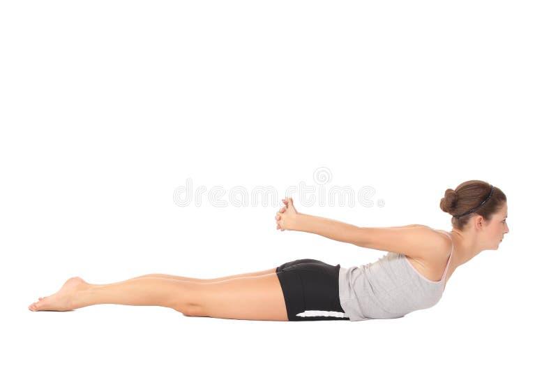 Yoga del entrenamiento de la mujer joven fotografía de archivo