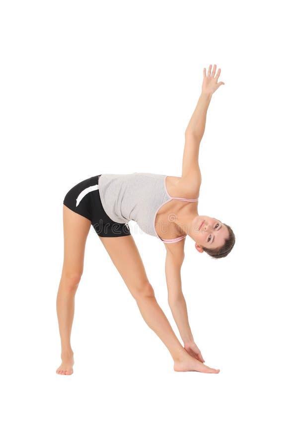 Yoga del entrenamiento de la mujer foto de archivo libre de regalías