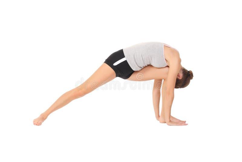 Yoga del entrenamiento de la mujer imagen de archivo libre de regalías