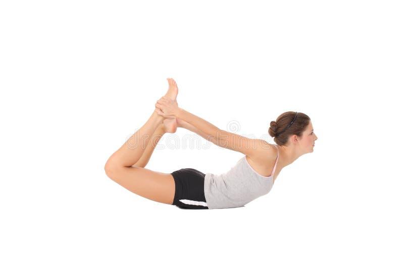 Yoga del entrenamiento de la mujer foto de archivo