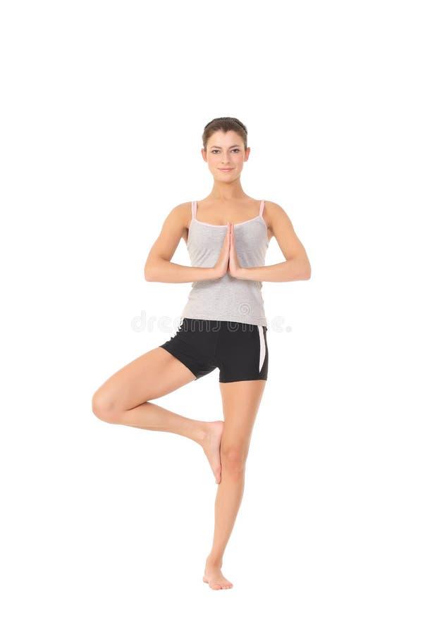 Yoga del entrenamiento de la mujer fotografía de archivo libre de regalías