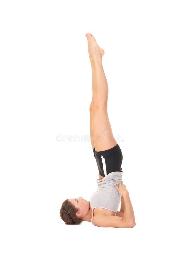 Yoga del entrenamiento de la mujer fotos de archivo libres de regalías
