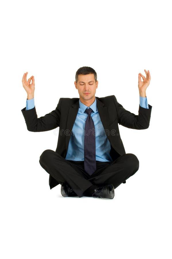 Yoga di pratica dell'uomo d'affari immagini stock libere da diritti