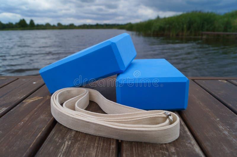 Yoga equipment near water. stock image