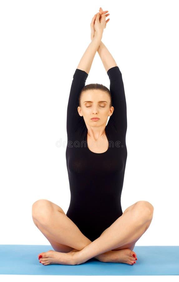 Yoga exercise on white royalty free stock photo