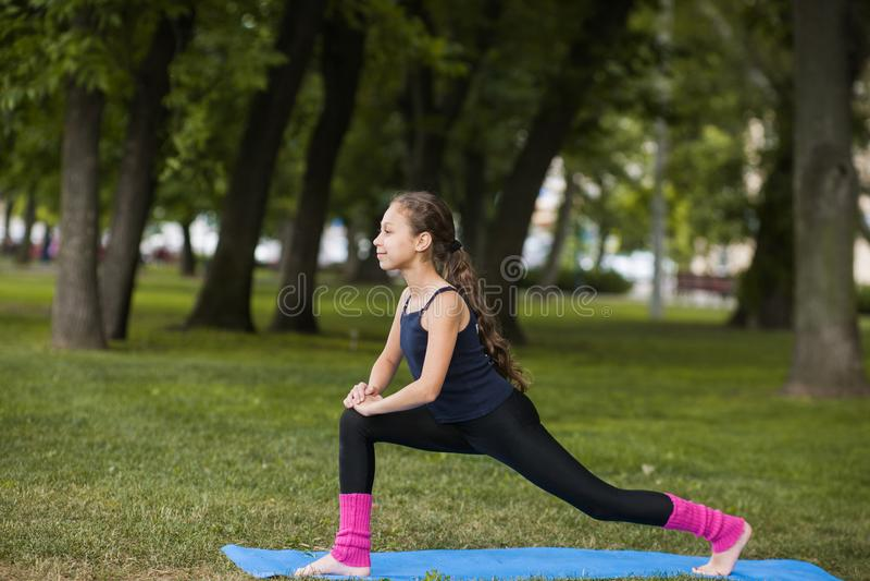 Yoga exercises. Teenage healthy lifestyle royalty free stock photography