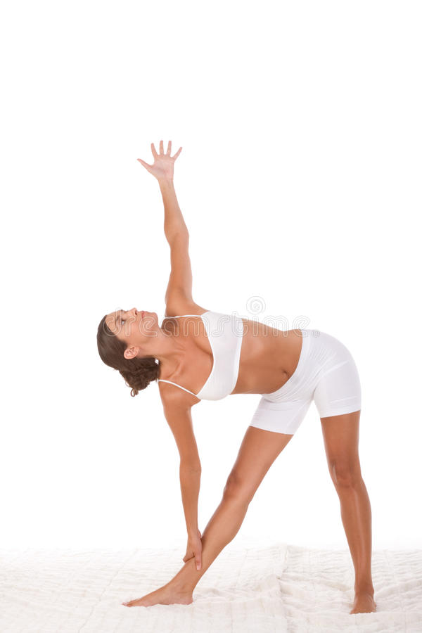 Yoga female in sport clothes performing exercise royalty free stock images