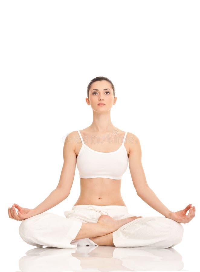 Yoga, femme en position de lotus photo libre de droits