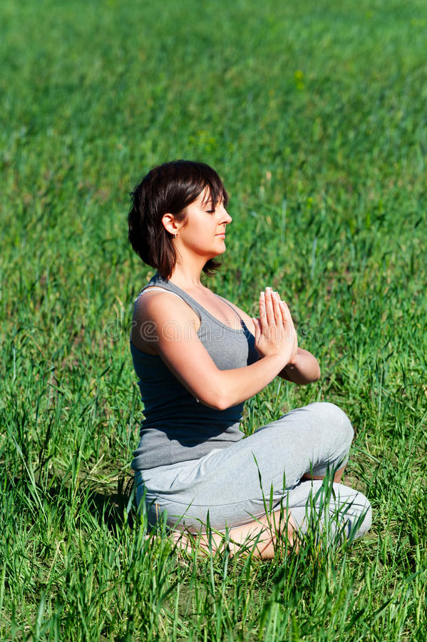 Download Yoga at the field stock image. Image of peaceful, woman - 25337809