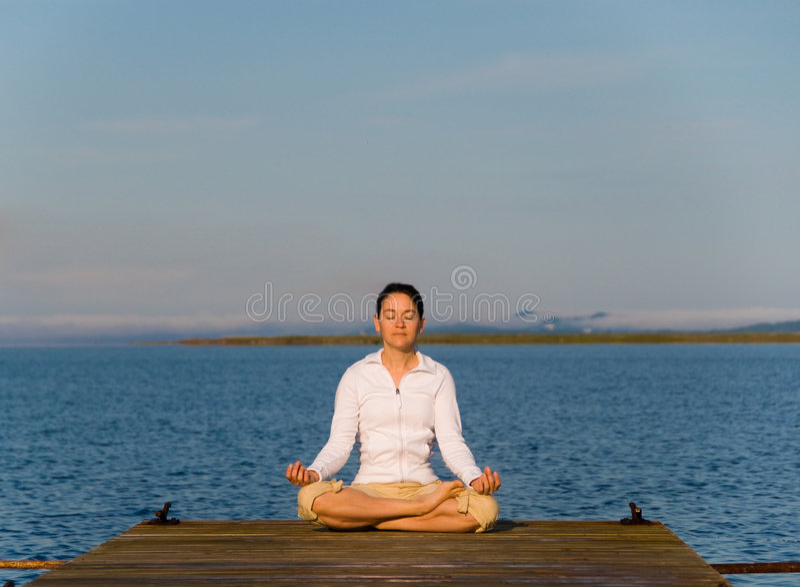 Yoga-Frau stockfotografie