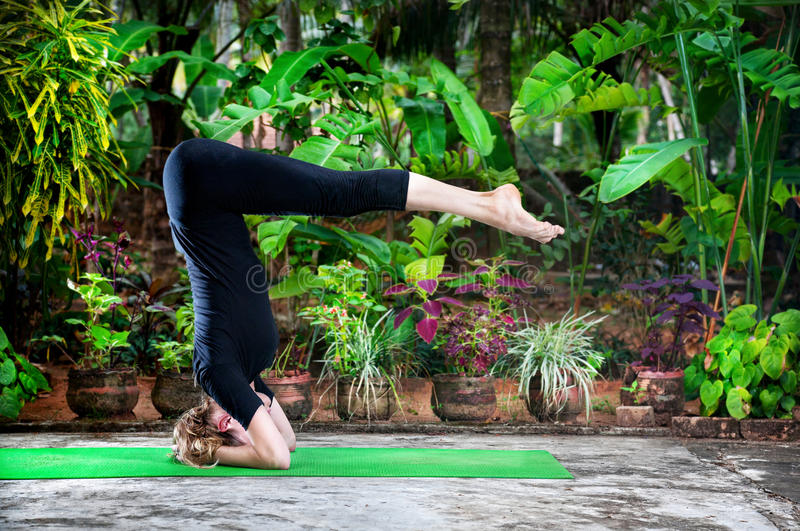 Download Yoga in the garden stock image. Image of headstand, meditation - 26013353