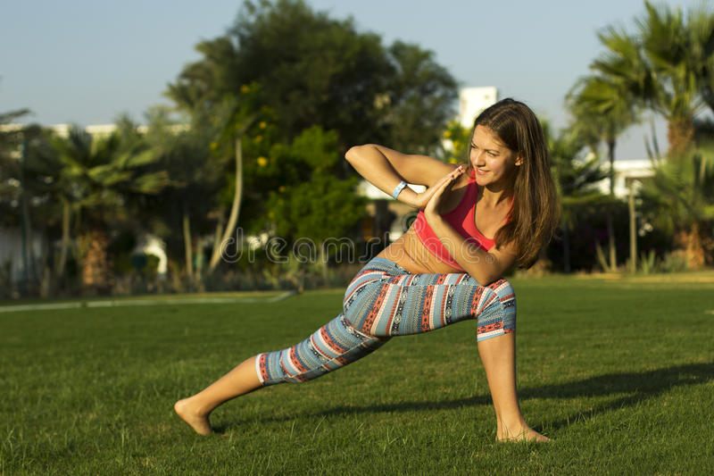 Yoga girl doing exercise royalty free stock image