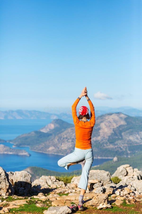 Yoga. Girl exercising Yoga on a beautiful seashore royalty free stock photography