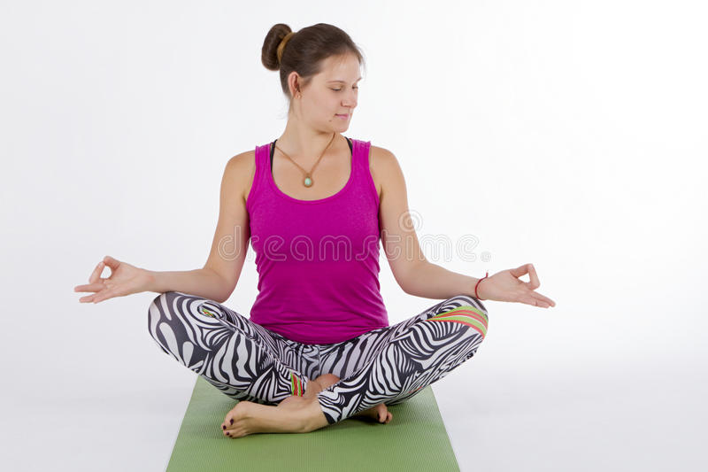 Yoga girl sitting stock image