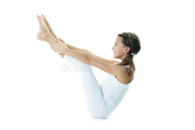 Yoga girl. A yoga girl on studio white background stock photos