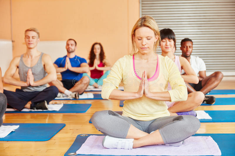 Yoga group during meditation exercise stock photography