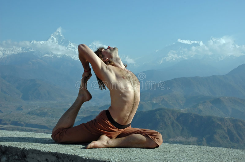 Yoga in Himalayas stock photo