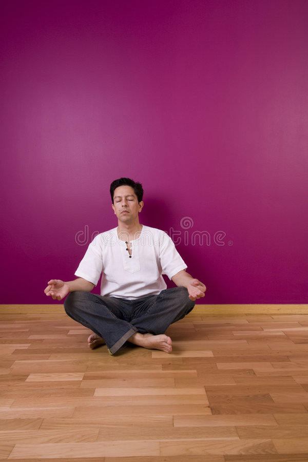 Yoga indoor. Next to a color wall stock images