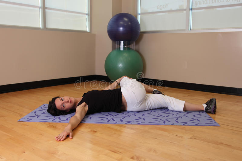 Download Yoga leg twist stock image. Image of relax, motion, building - 25395407