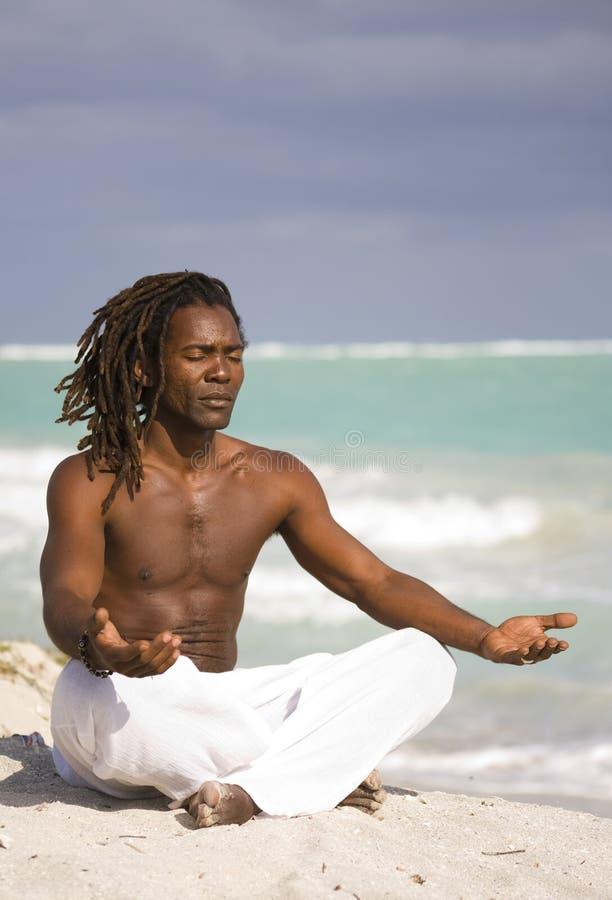 Yoga man in cuba royalty free stock photo