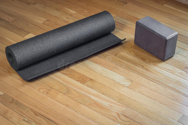 Yoga Mat and Brick royalty free stock images