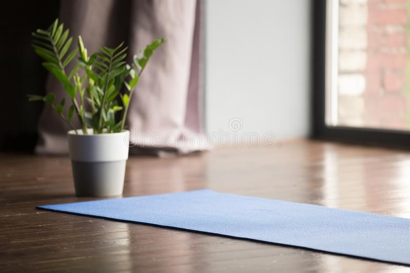 Yoga mat on the floor, blue carpet stock images