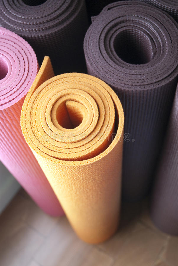 Yoga Mats. Colorful yoga mats in a yoga studio