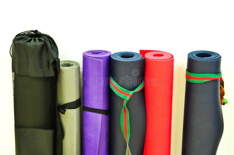 Yoga mats on floor with white background royalty free stock photos