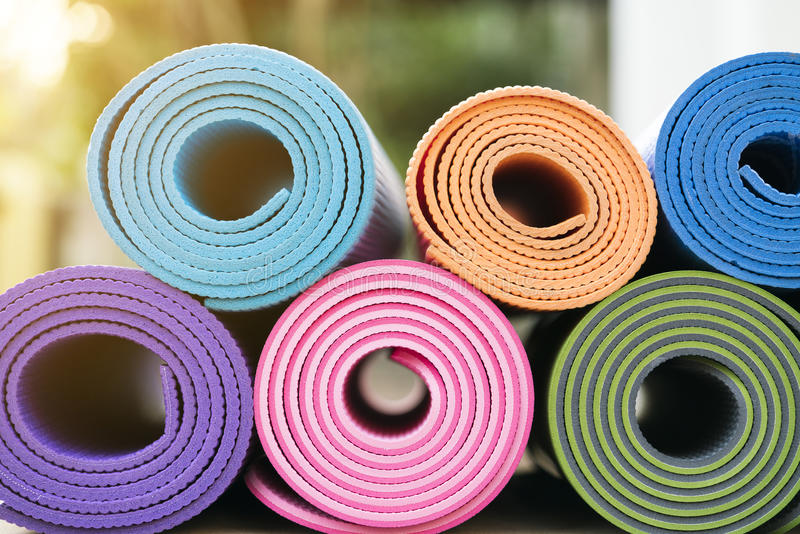 Yoga mats in the garden stock images