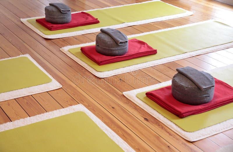Yoga mats and Yoga Cushion royalty free stock images