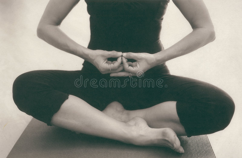 Yoga Meditation. The hands and body of a woman in meditation. Scan of alternative fine art photo print on Kozo paper. This image crops beautifully to the hands royalty free stock image