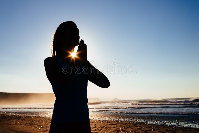 Yoga meditation and relax at beach royalty free stock photo