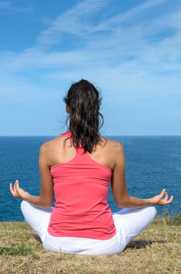 Download Yoga meditation and sea stock photo. Image of enjoyment - 26438014