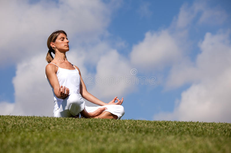 Yoga at the nature stock image