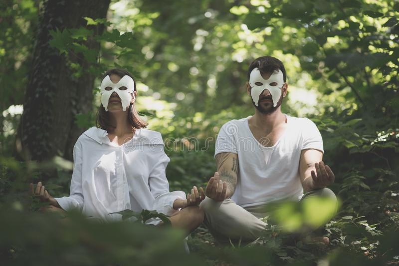 Yoga in nature. Hidden face. Concept. royalty free stock photography