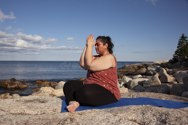 Yoga outside by the ocean royalty free stock image