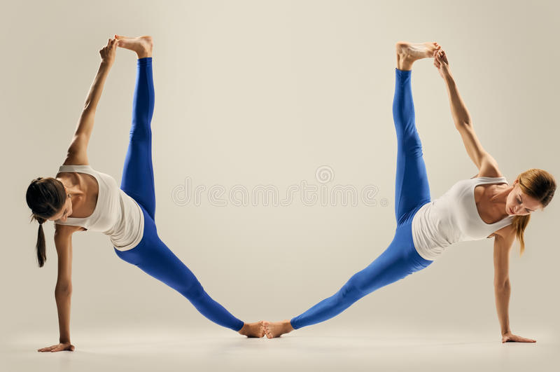 Yoga In Pair. Figure. The Splits Stock Image - Image of friend ...