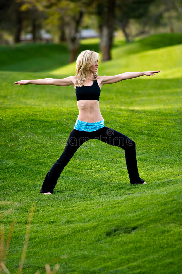Yoga In The Park - Warrior Pose Royalty Free Stock Photography