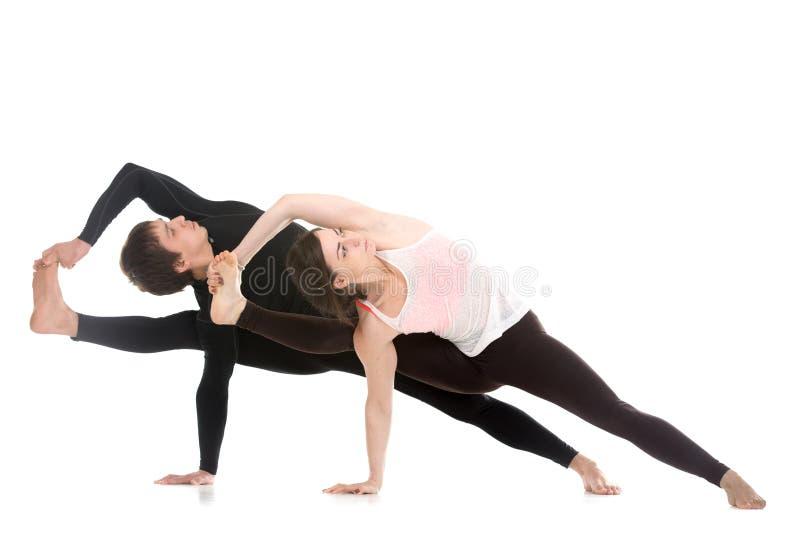 Yoga with partner, Vishvamitrasana stock photo