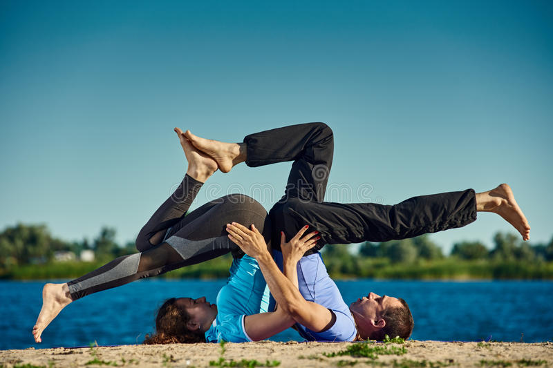 Yoga with partner royalty free stock photography