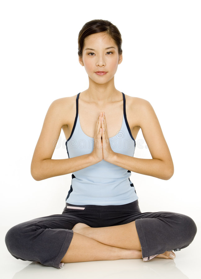 Yoga Pose. A pretty young asian woman in a meditative yoga pose stock photos