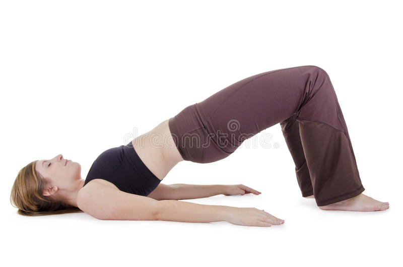 Yoga pose. Female in sport clothes performing exercise, isolated on white royalty free stock photos